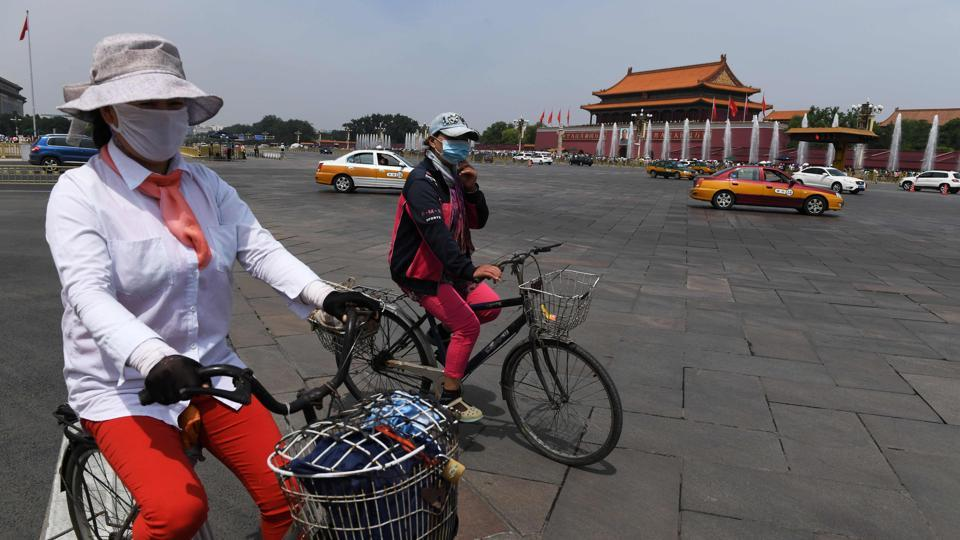 Cyclists ride past Tiananmen Gate on June 3, 2017, the eve of the 28th anniversary of the June 4, 1989 crackdown on pro-democracy protests in Beijing. The Tiananmen pro-democracy movement ended in bloodshed when tanks crushed the demonstrations, killing hundreds of protesters.