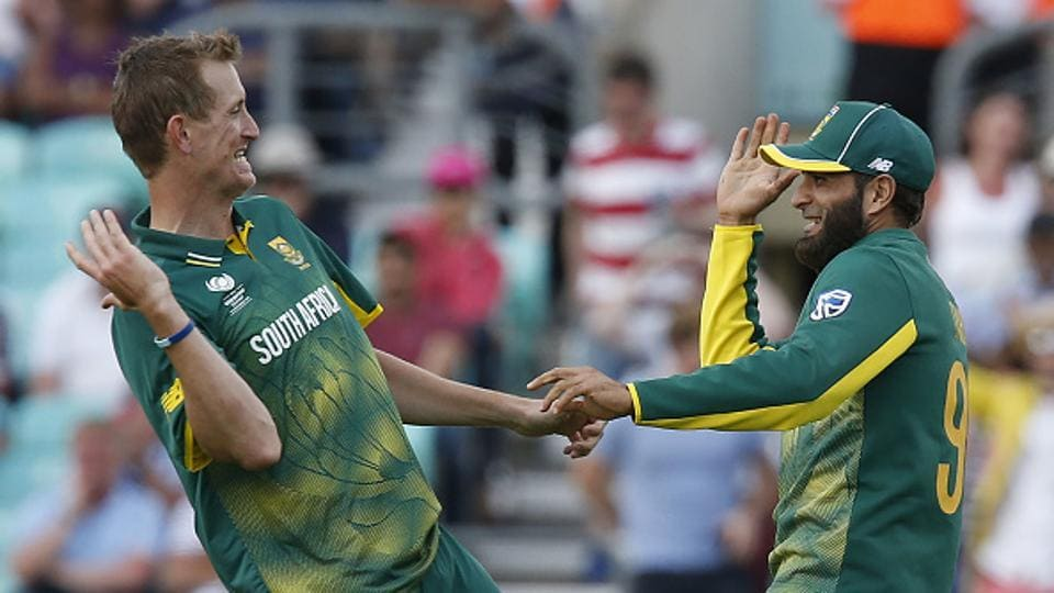 Tahir and paceman Chris Morris shared six wickets between them as South Africa registered their first win of the tournament.  (AFP/Getty Images)