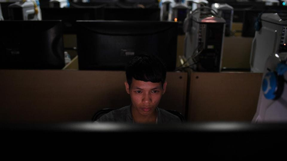 A worker in an internet cafe at the Huajian shoe factory in Dongguan, in south China's Guangdong province.