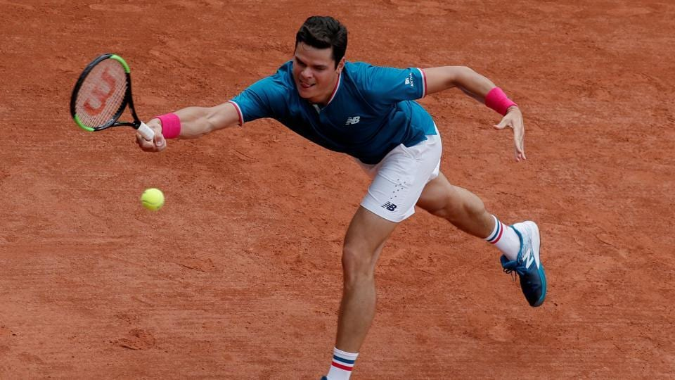 Canada's Milos Raonic defeated Spain's Guillermo Garcia-Lopez in his third round match. (REUTERS)