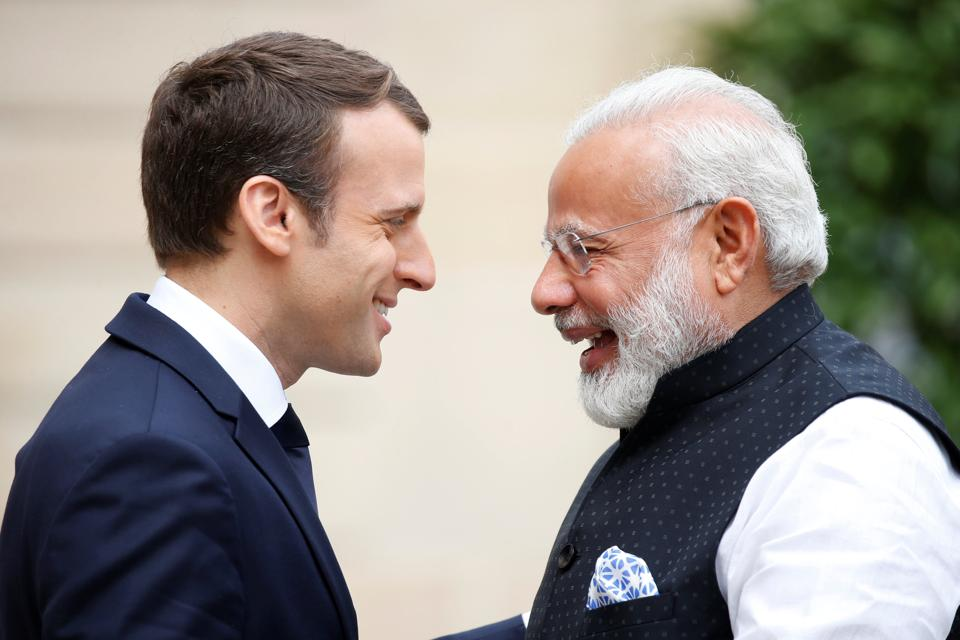 Prime Minister Narendra Modi (R) with French President Emmanuel Macron at the Elysee Palace in Paris.  After realising that Europe can contribute significantly to the NDA's domestic economic agenda, the Prime Minister has visited Belgium, France, Germany, Ireland, Netherlands, Portugal, Spain, Switzerland and the UK.