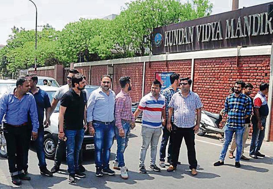 Parents protesting outside Kundan Vidya Mandir, Civil Lines, in Ludhiana on Saturday.