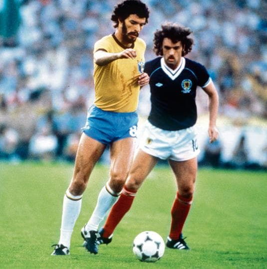 Legend: Scotland's John Wark marks Brazilian captain Socrates at the 1982 World Cup Finals in Seville, Spain on June 18, 1982.
