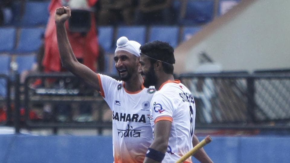 Mandeep Singh (left) scored for Indian hockey team in the 45th minute of their match against Germany Hockey team in Dusseldorf on Saturday.