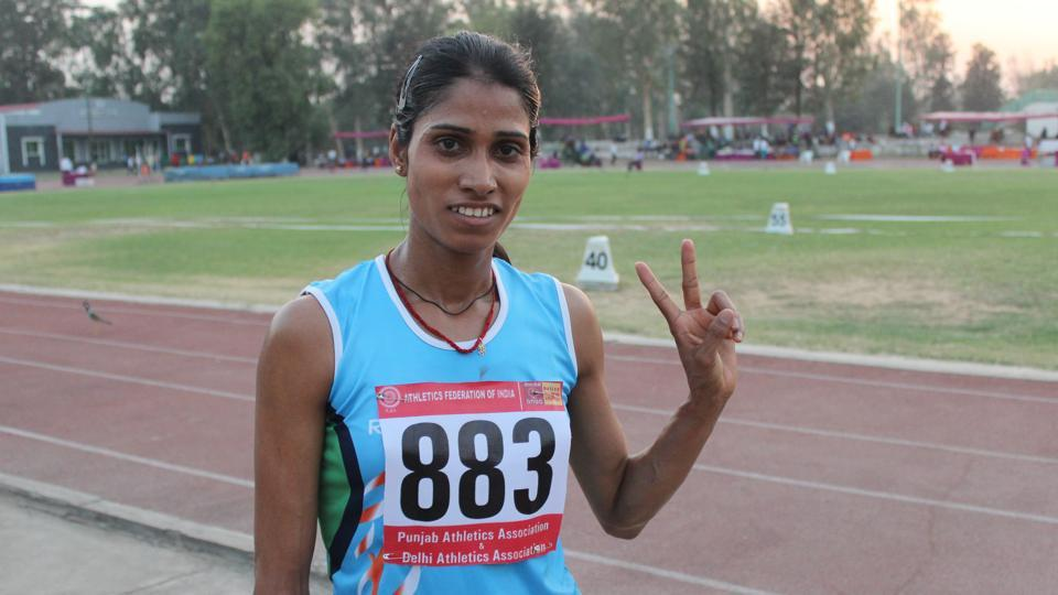 Sudha Singh celebrates after winning the 3000m steeplechase gold at the Federation Cup athletics championships in Patiala on Saturday.