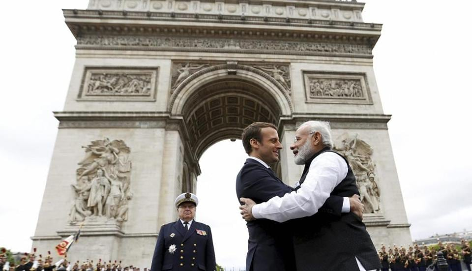 Indian Prime Minister Narendra Modi hugs French President Emmanuel Macron, centre as they attend a ceremony at the Arc de Triomphe in Paris, France, Saturday, June 3, 2017.