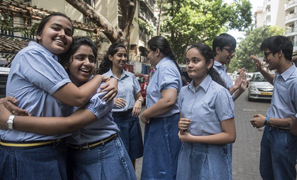 Students celebrate after their CBSE results were declared.