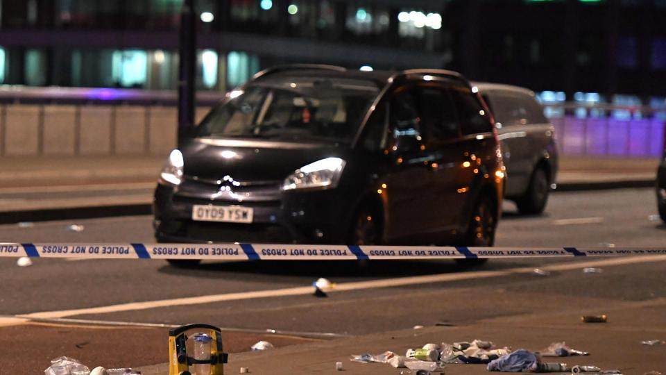 Debris and abandoned cars remain on London at the scene of an apparent terror attack in central London on June 3, 2017. Armed police fired shots after reports of stabbings and a van hitting pedestrians on London Bridge on Saturday in an incident reminiscent of a terror attack in March just days ahead of a general election.