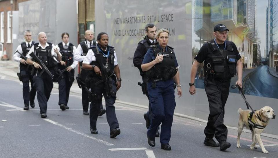 British police officers walk with a detection dog after an attack in the London Bridge area of London.