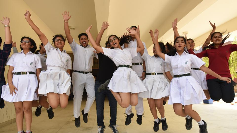 Students of a school in Noida celebrate their good performance in the CBSE class 10 exams.