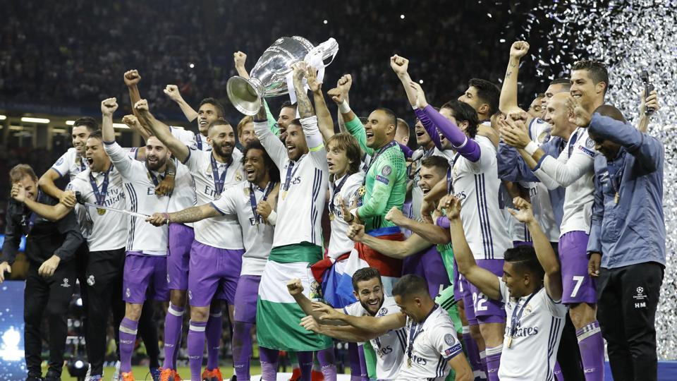 Real Madrid players celebrate with the trophy after winning the UEFA Champions League final against Juventus in Cardiff. Catch highlights of Juventus vs Real Madrid here.