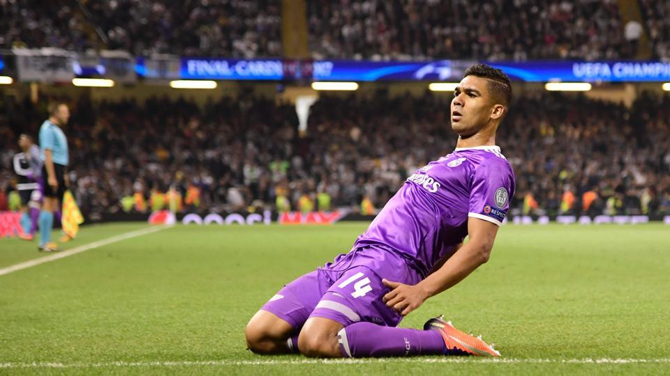 Casemiro restored Real's lead at the hour mark with a thunderous shot from outside the box, which took a deflection on its way to the goal. (AFP)