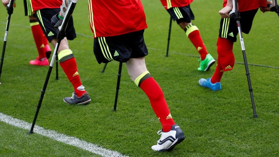 Football Soccer - Belgium's national soccer team training - King Baudouin stadium, Brussels, Belgium - 3/6/17 - Members of the Belgian disabled soccer team walk on the pitch during a training session of the Belgian national squad.  (Francois Lenoir  / REUTERS)