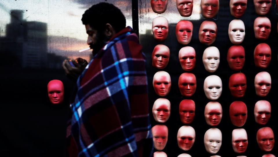 A homeless man walks past masks depicting faces of politicians during a protest by non-governmental organization (NGO) Rio de Paz (Rio of Peace) against political corruption scandals at Paulista Avenue in Sao Paulo, Brazil. (Nacho Doce  / REUTERS)