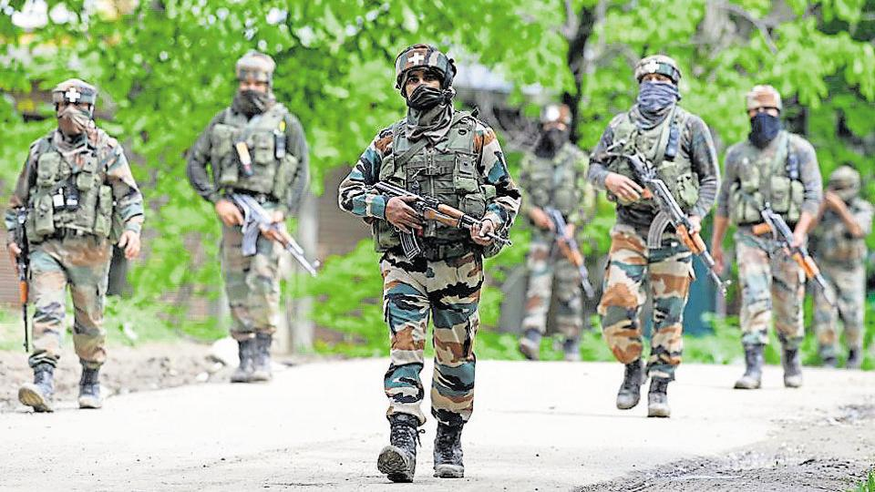 Indian army soldiers conduct a patrol during an operation against suspected rebels in Turkwangam Lassipora in Shopian south of Srinagar on May 4.
