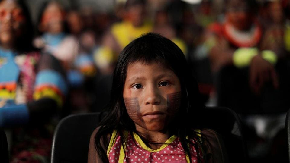 Indigenous people Xikrin of north Brazil participate in a session in the Brazil Supreme Court, that discusses the environmental impacts of a mining project on the Catete River that crosses the lands of the Xikrin Indian reservation, in Brasilia, Brazil. (Ueslei Marcelino / REUTERS)