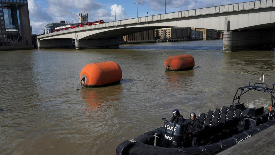 A police boat travels along the Thames next to London Bridge after an attack left 7 people dead and dozens injured in London, Britain on June 4.