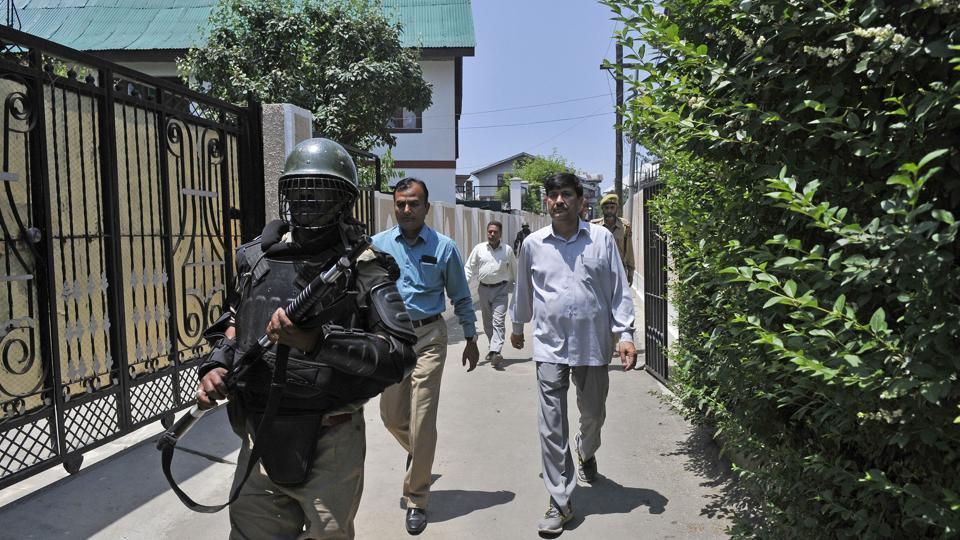 A NIA team during a raid in Sanat Nagar, Srinagar.