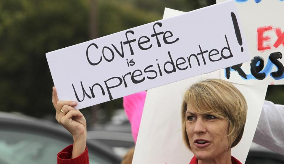Demonstrator Annette Lievers carries a sign concerning a recent Trump tweet as she joined about 200 demonstrators before a town hall meeting in San Juan Capistrano, California, on Saturday.
