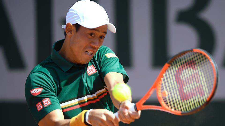 Japan's Kei Nishikori returns the ball to South Korea's Hyeon Chung during their tennis match at the Roland Garros.