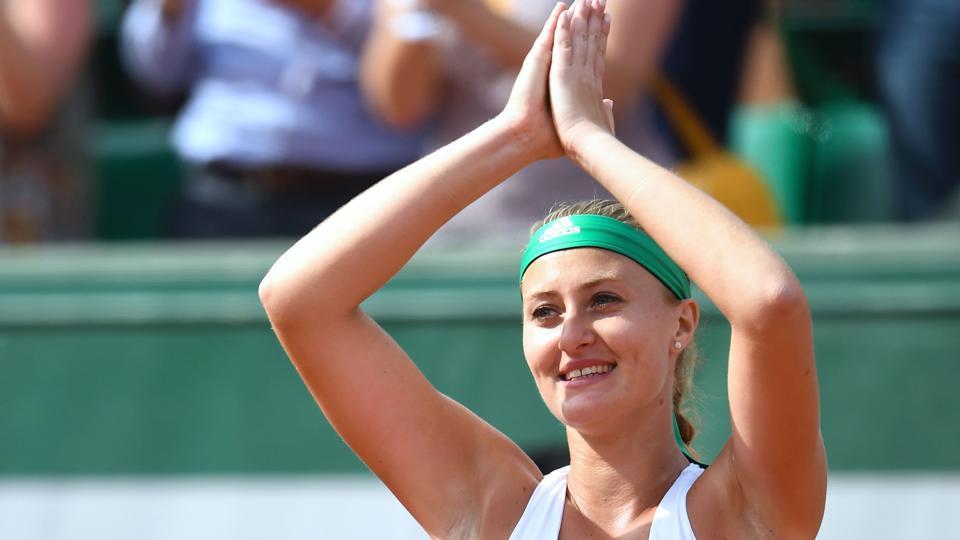 Kristina Mladenovic celebrates after beating Garbine Muguruza in their French Open match at the Roland Garros on Sunday.
