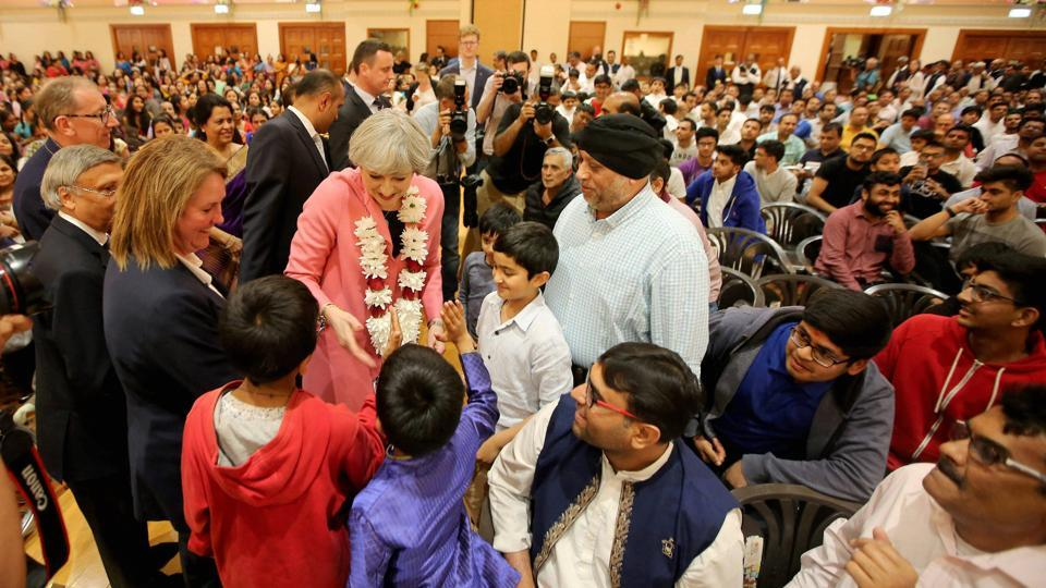 British Prime Minister Theresa May meeting devotees at BAPS Shri Swaminarayan Mandir, London on Saturday.