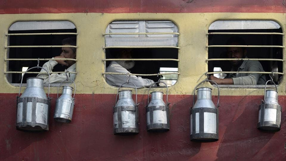Indian milkmen on a train with their containers of milk as they transport it from farms to supply villages surrounding Jalandhar in northern Punjab state. Indian milkmen in Punjab take the public trains each day to transport dairy products from farms to the villages surrounding Jalandhar. (SHAMMI MEHRA / AFP)