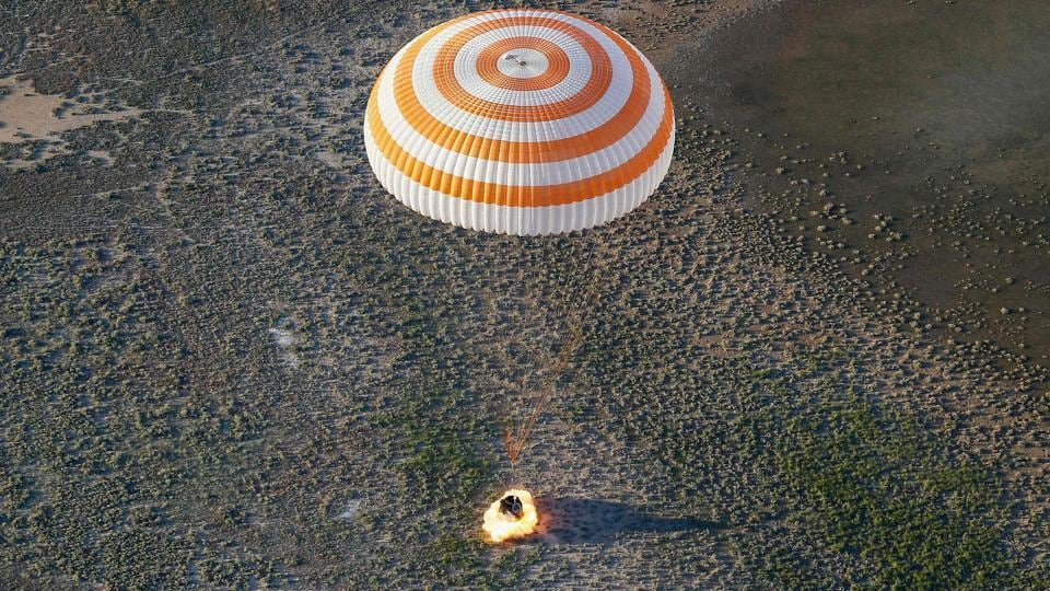 The Soyuz MS-03 space capsule carrying the International Space Station (ISS) crew of Russian cosmonaut Oleg Novitskiy and French astronaut Thomas Pesquet lands in a remote area outside the town of Dzhezkazgan (Zhezkazgan), Kazakhstan. (SHAMIL ZHUMATOV / AFP)