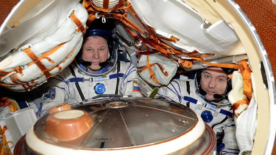 European Space Agency shows ESA French astronaut Thomas Pesquet (R) with Russian commander Oleg Novitsky in their Soyuz MS-03 spacecraft docked to the International Space Station at the end of his six-month Proxima mission. French astronaut Thomas Pesquet is due to return to Earth on June after a marathon 196-day trip that will fall just shy of a record space mission for a European. (AFP)