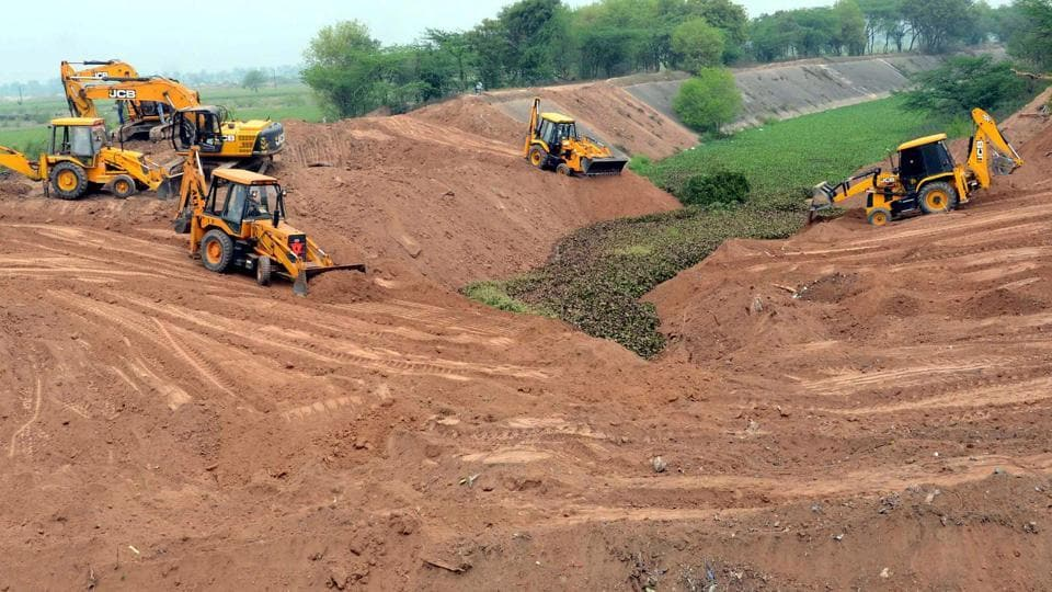 Farmers of Jhansla village in Patiala district levelling the SYL canal with the help of earthmoving machines in March 2016, after the Punjab assembly passed a bill providing for transfer of proprietary rights to the original owners.