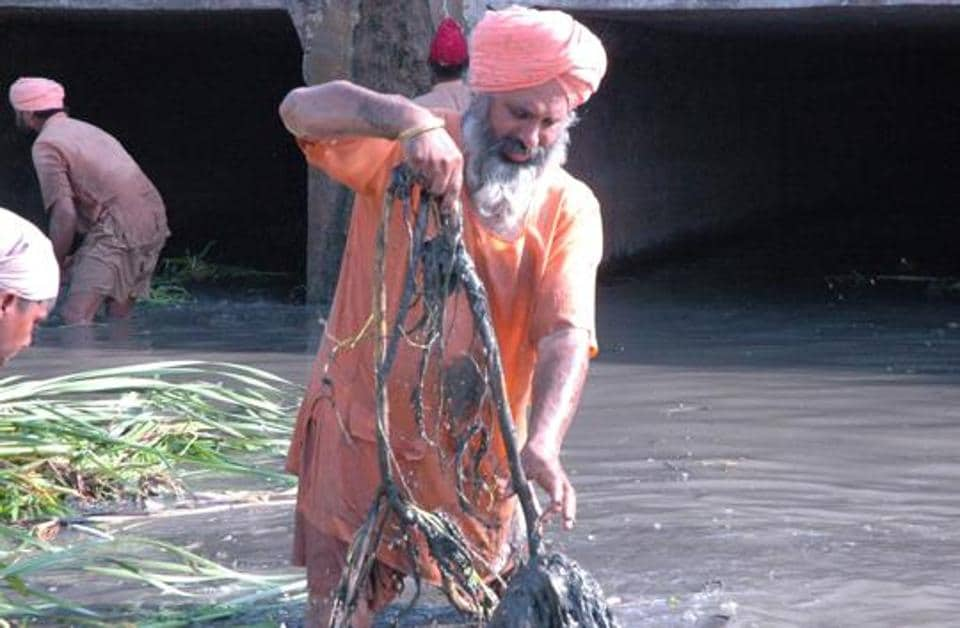 Balbir Singh Seechewal is worried about the condition of Kala Sanghian drain that flows through Jalandhar city and is filled with sludge, filth, garbage and medical waste.