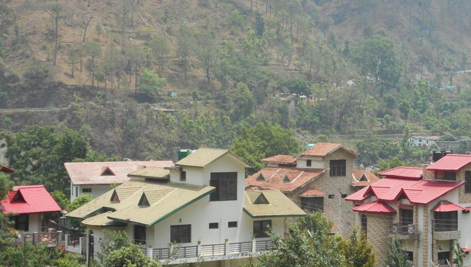 Cottages built by wealthy outsiders on the land sold by villagers in Chamfi on way to Mukteshwar.