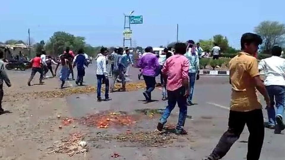 Farmers protest on a road in Sehore in Madhya Pradesh on Sunday, June 4, 2017.