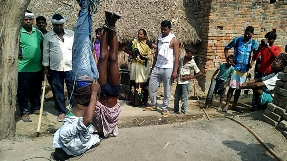 This picture shows the victims being assaulted at Sonbarsa vilage in Kaimur district of western Bihar, on Saturday.