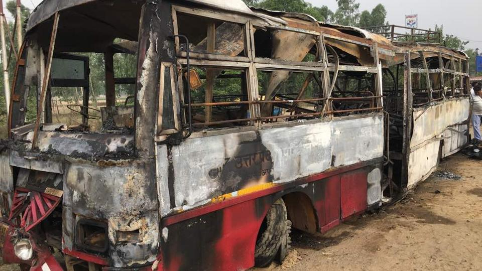 22 killed as bus catches fire after collision