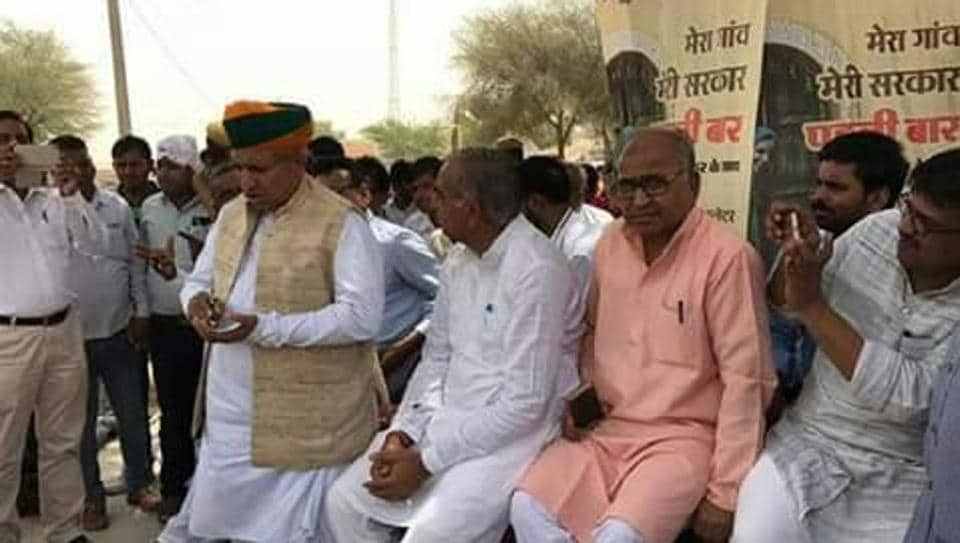 Union minister Arjun Ram Meghwal with villagers in Bikarner district in Rajasthan.
