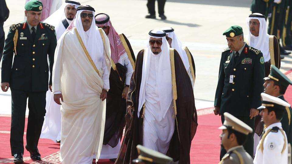 FILE PHOTO - Saudi Arabia King Salman bin Abdulaziz (C) walks with the Emir of Qatar Tamim bin Hamad al-Thani during a welcoming ceremony upon Hamad al-Thani's arrival to attend the Summit of South American-Arab Countries, Riyadh,  November 10, 2015