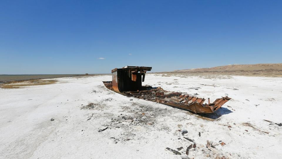 A ruined ship lays on a salinated part of the Aral Sea coastline near the village of Akespe, south-western Kazakhstan.The Aral Sea, once the world's fourth biggest lake, is most likely gone forever, its death having brought about decades of environmental disaster. However, a project to salvage its northern part appears to have succeeded as commercial fishing is once again viable in the adjacent Kazakh towns and villages. (Shamil Zhumatov / REUTERS)