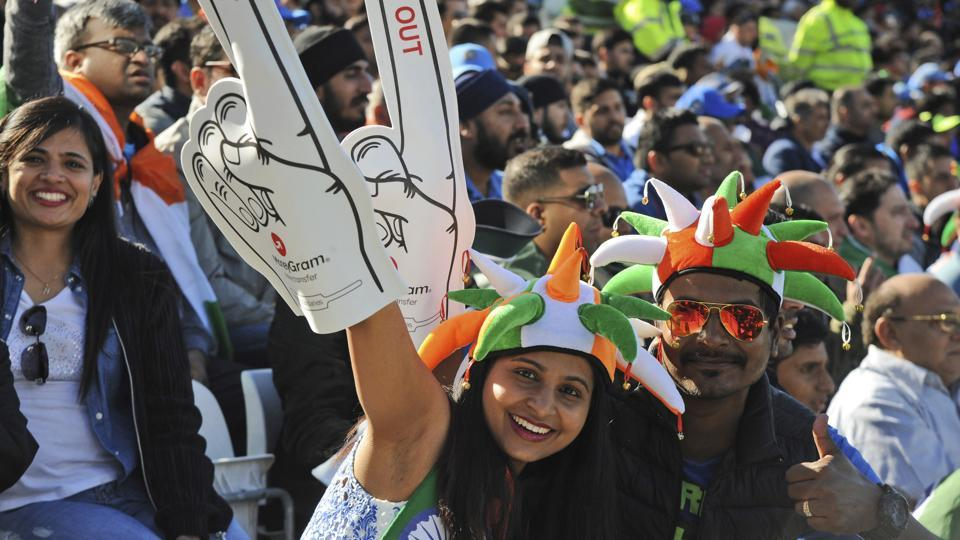 Indian cricket fans cheers for their team during the ICC Champions Trophy match between India and Pakistan. (AP)