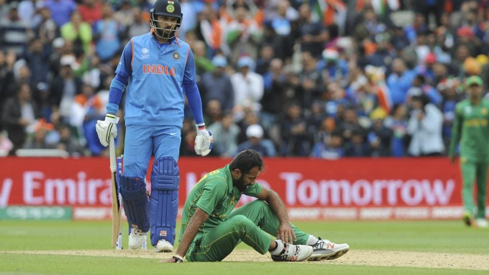 Wahab Riaz sits on the field holding his ankle after an injury during the ICC Champions Trophy 2017 match between India and Pakistan.