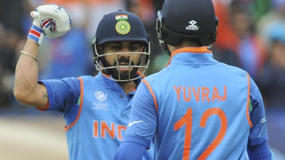 Indian cricket captain Virat Kohli congratulates teammate Yuvraj Singh for scoring fifty runs during the ICC Champions Trophy match against Pakistan.