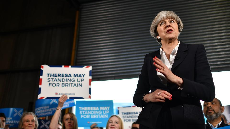 British Prime Minister Theresa May speaks during an election campaign visit to a removals depot in Edinburgh, Scotland, on June 5, 2017. Britain goes to the polls on June 8 to vote in a general election only days after another terrorist attack in London.