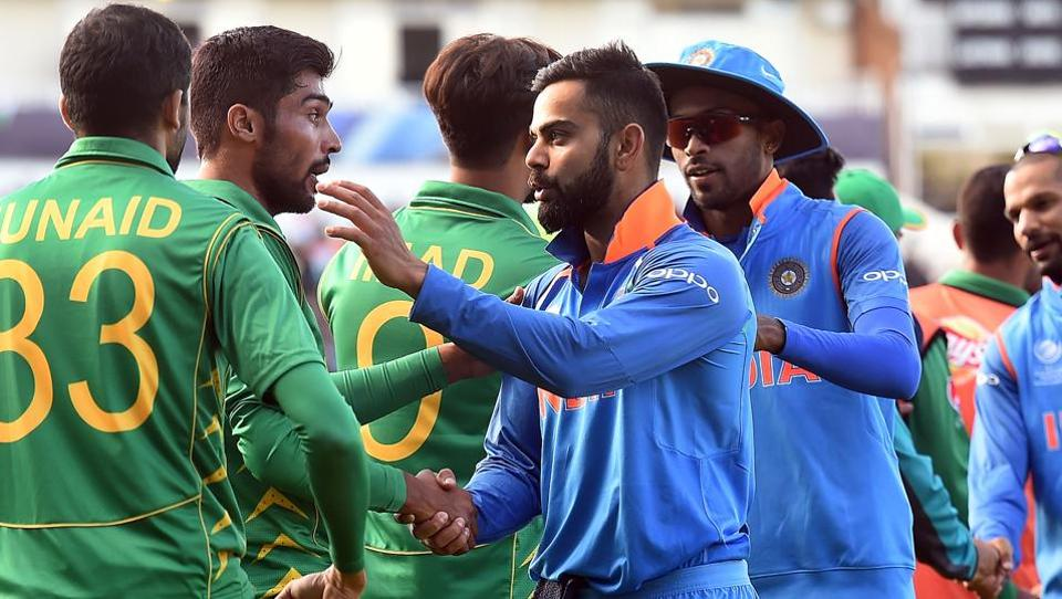 Virat Kohli (C) shakes hands with Pakistan players after the ICC Champions trophy match between India and Pakistan at Edgbaston in Birmingham. (AFP)