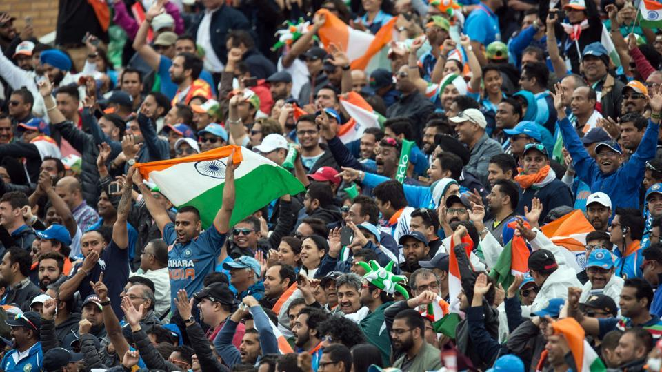 Indian cricket fans cheer and wave national flags during the ICC Champions trophy match between India and Pakistan. (AFP)