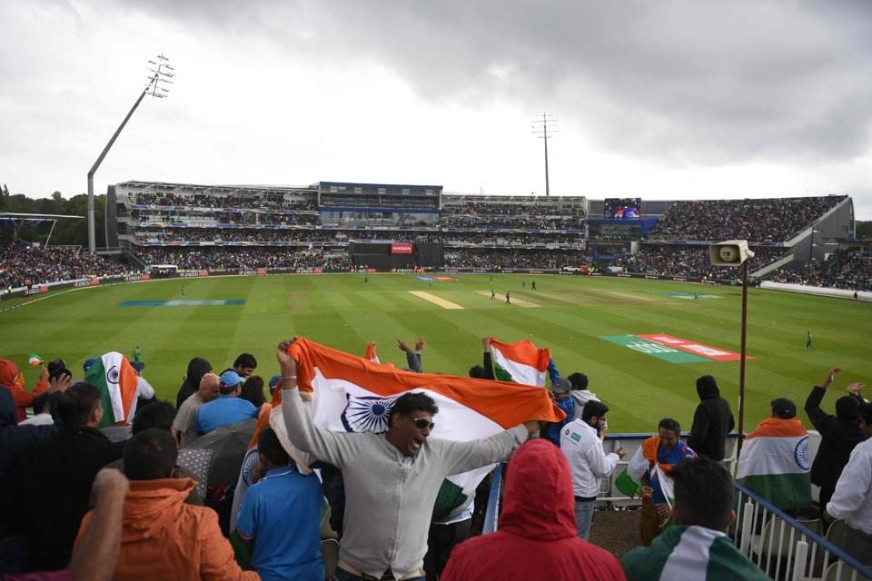 Indian cricket fans wave the national flag during the ICC Champions trophy match between India and Pakistan. (AFP)
