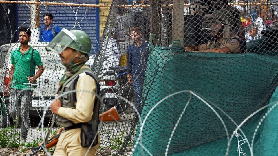 Security personnel keep vigil from a temporary bunker in Srinagar following the killing of four heavily armed militants who had tried to storm a CRPF camp in a pre-dawn suicide attack in Bandipora district of Jammu and Kashmir on Monday, June 5, 2017.