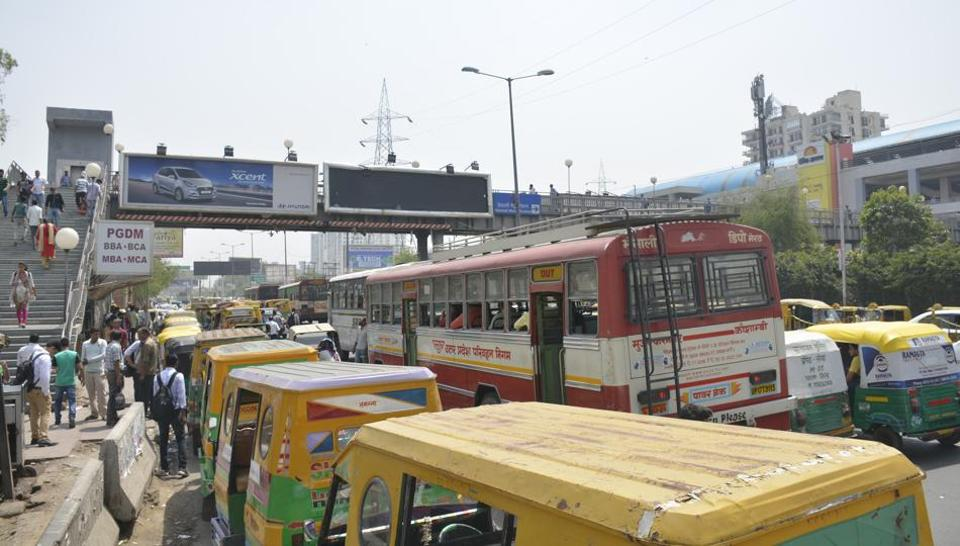 Unauthorised parking of autorickshaws and buses have eaten into the road space around the metro station.