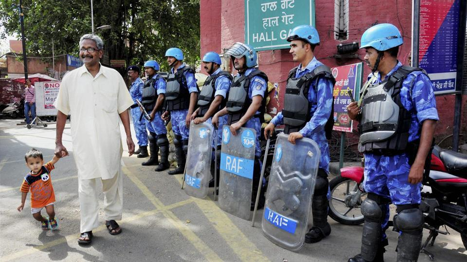 Rapid Action Force (RAF) personnel stand guard on the eve of Operation Bluestar anniversary in Amritsar on Monday.