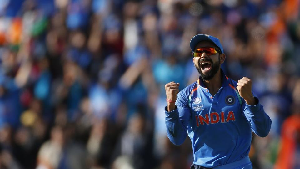 Indian cricket team captain Virat Kohli celebrates the wicket of Pakistan's Azhar Ali  in the Champions Trophy match, Sunday, June 5, 2017.