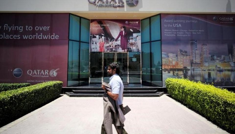 A man walks past Qatar Airways office in Manama, Bahrain, on June 5.